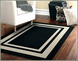 large black area rug rugs and white grey checd