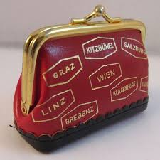 vintage leather suitcase sewing kit made in austria advertising piece to expand