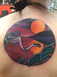 Flamingo With Sun And Sea With Island In Circle Tattoo On Upper Back