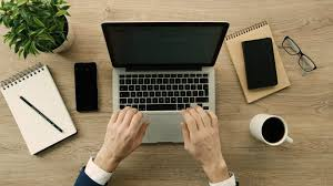 office desk wallpaper. Business Man Working And Writing In Laptop On Office Desk Wallpaper