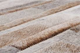 patchwork cowhide rug in stripes of gray beige and white hair on hide rugs whole