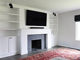 modern built in shelves and fireplace brittanymakes