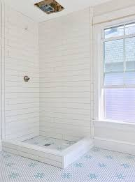 and here s the hall bathroom all tiled except for a little bit of one wall and the curb around the front of the shower floor john ran out of thinset and