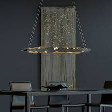in 2018 hubbardton forge introduced the griffin pendant featuring exquisite blown glass from renowned glassmaker simon pearce