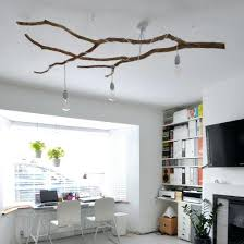 sophisticated tree branch decor learn how to create a statement chandelier light out of the fallen
