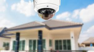 A house with a security camera outside. St. Louis Area Police Partner With Residents to Use Home Security
