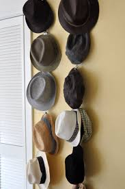 DIY Hat Storage: Take a piece of twine and some metal art clips (the kind  with holes in the top). Tie art clips about a foot apart on the twine, ...