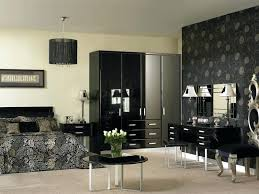 Captivating Black Bedroom Cabinets Fitted Bedroom Furniture Shown In High Gloss Black  Black Gloss Bedroom Furniture Sets . Black Bedroom ...