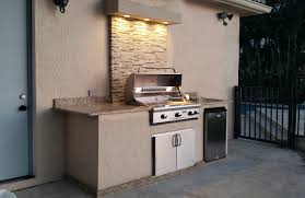 outdoor grill island with tiled back wall