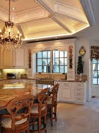 example of a large classic u shaped ceramic floor and beige floor open concept kitchen