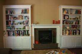 Living Room Cabinet Storage Stone Fireplace Among White Wooden Bookshelf And Cabinet Storage
