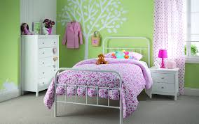 this y room uses white to break up the pink and green with creative use of