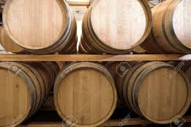 stacked oak barrels maturing red wine. Stacked Oak Barrels For Maturing Red Wine And Brandy In A Cooling Cellar. Made From D
