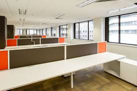 images office space. vacant office space with empty desks separated by partitions images
