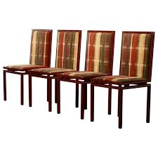 set of four dining room chairs by pierre vandel paris