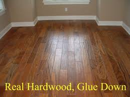... Amazing Laminate Or Wood Flooring Laminate Flooring Or Wood Beauteous  Laminate Vs Wood Floors Home ...