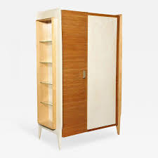 Design italian furniture Interior Extraordinary Twodoor Storage Cabinet By Gio Ponti Circa 1952 This Piece Has Parchment Covered Panels One Ribbed Door Panel And Sculptural Bronze Calligariscom Italian Furniture Design Masters Who Changed The World Of Design