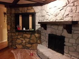 painted stone wallPainted stone fireplace makeover