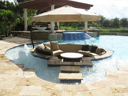 Dramatic pool retaining wall topped with privacy hedge