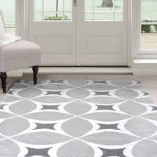 bedroom white area rug plain gray wallpaint black bedside table mirrored dark purple tufted velvet