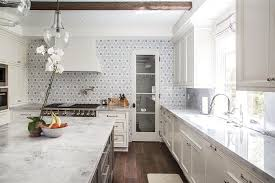 white marble countertops gray flower mosaic tile backsplash