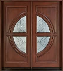 large double brown wooden door with round glass ornaments on the middle
