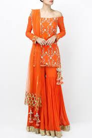 Off Shoulder Designer Suits Featuring An Orange Off Shoulder Full Sleeved Kurta Based In