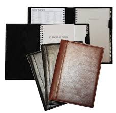 inside and outside views of black burdy and cognac glazed leather 5 x 8 planner