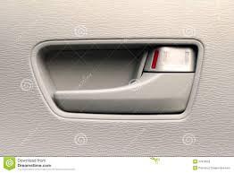 close up of an interior car door handle