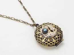 steampunk locket necklace antique watch movement gears blue swarovski crystal gold brass filigree