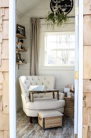 stylish she sheds cottage shed exterior with arm chair and wood panel walls nonagon