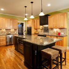 oak and two tone kitchen cabinets upper oak cabinets under