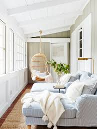 Example of a coastal brick floor sunroom design in San Francisco with a  standard ceiling