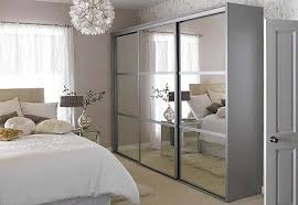 image mirrored sliding. Mirror Design Ideas, White Framed Wardrobe With Mirrored Sliding Doors High Quality Wood Natural Relaxing Image T