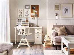 living room desks furniture: a corner in the living room with a white desk and a swivel chair