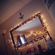 tumblr room. mirror with lights around them:)