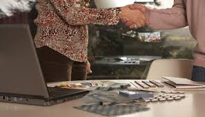 concept statement interior design. Man And Woman Shaking Hands At Desk, Mid Section. An Interior Design Concept Statement
