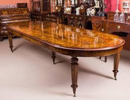 this is a stunning bespoke handmade victorian style extending burr walnut and marquetry dining