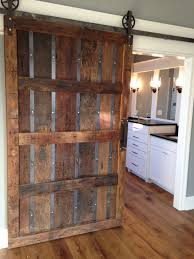 vine industrial spoked european sliding barn door by thewhiteshanty at etsy