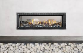 mezzo see through direct vent modern fireplace shown with the loft forge front that