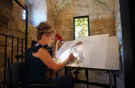 artist sherry steele works on a portrait of susanna inson a 22 year