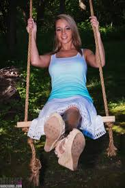 Amateur model Nikki Sims in lace skirt showing nice tits on swing.