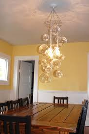 remarkable bubble light chandelier bubble chandelier pelle yellow black seat table window wood