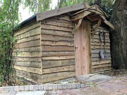 pallet shed. pallet shed extension with waney edge cladding, unexpected from garden owned by neil #shedoftheyear