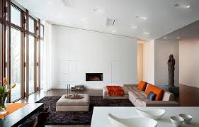 View in gallery Living space with slanted ceiling that is far less dramatic