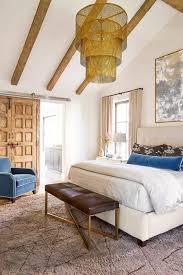 bedroom with gold drum chandelier