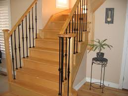 Wrought iron  Tips Use of Wood Stair Railings - http://www.potracksmart.com