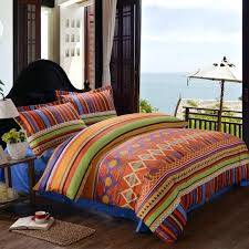 aztec crib bedding set bohemian southwestern style rust orange navy yellow and green urban
