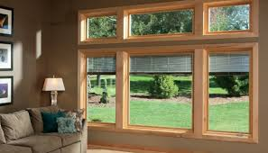 living room with designer series casement windows and blinds
