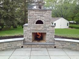 outdoor stone fireplace with oven